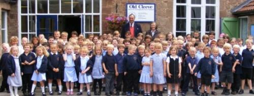 Mr. And Mrs. Theed with the children of Old Cleeve C of E First School, Washford.
