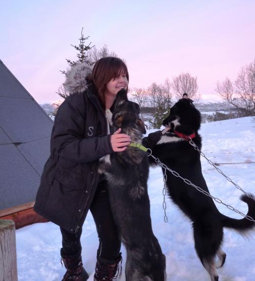 Amanda Halliday with two husky dogs