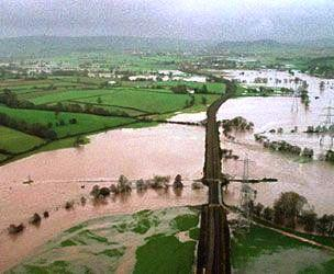 Aeriel view of flooded fields and railway line