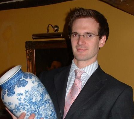 Charles Hanson MRICS holding antique vase