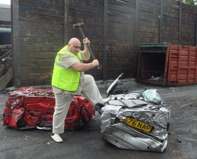 Cllr Mark Aaron smashing up cars at ...