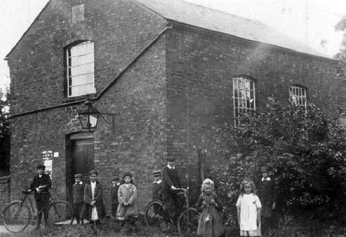The 1859 Chapel taken in about 1912. The girl in the white pinafore is thought to be Marjory Rush, who was born in 1905.