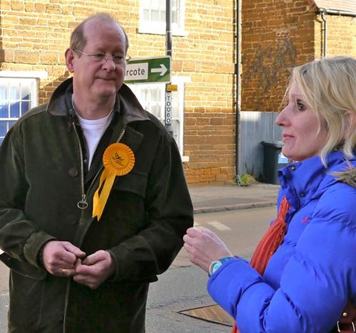 Liberal Democrat Parliamentary Candidate Chris Lofts discusses local issues with a resident.