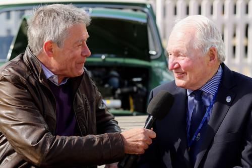 In homage to the original 'pocket rocket', Mini rallying and racing hero Paddy Hopkirk – reunited with his 1964 Monte Carlo Rally-winning car – interviewed here by racing drive and TV presenter Tiff Needell - photo Bob Halsey