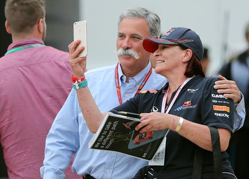 Chase Carey CEO of F1 with a fan in the paddock at Silvestone during the British Grand Prix