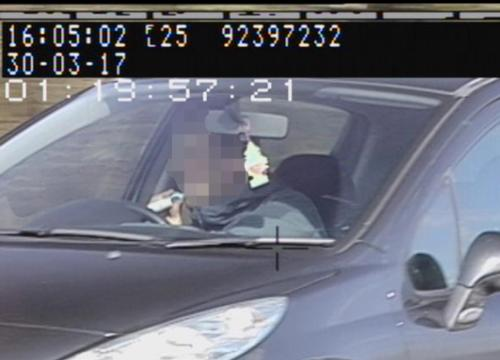Northamptonshire Police has released images of a driver caught brushing his teeth behind the wheel to highlight the dangers of distracted driving.