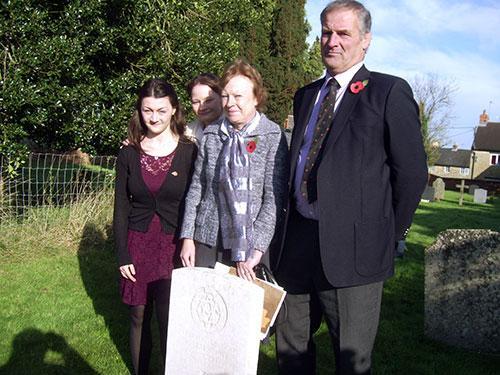 Claire West and her daughters Nicola and Rachel by the official headstone to Sgt Andrew Malsbury. with local farmer Frank Osborne who spoke about an American bomber that crashed on his farm during World War Two.