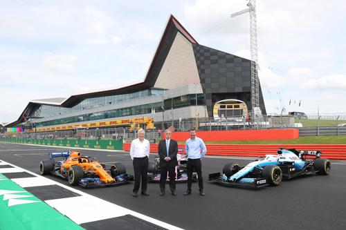 John Grant, Chairman, BRDC, Chase Carey, Chairman and CEO, Formula 1, Stuart Pringle, Managing Director of Silverstone Circuits Limited