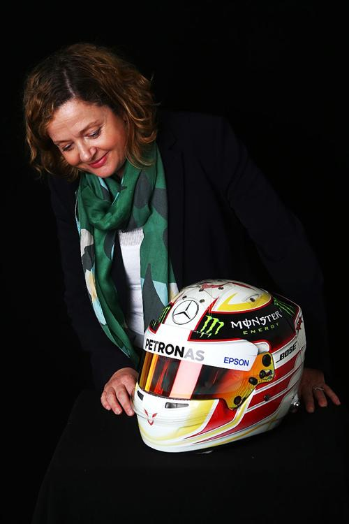 Sally Reynolds, Chief Executive Officer of The Silverstone Experience, photographed with latest exhibit to arrive for display - Lewis Hamilton's 2015 race helmet.  Image by Jakob Ebrey Photography