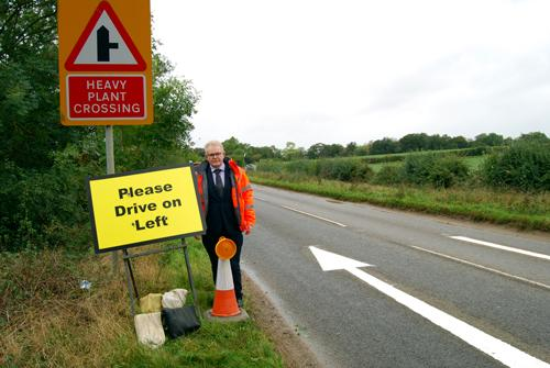 South Northamptonshire Council Leader, Cllr Ian McCord, with one of the temporary road signs at RAF Croughton.