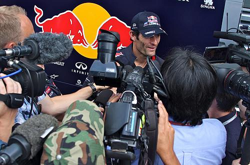 Mark Webber of Red Bull Racing - facing a media scrum in the Paddock on Friday
