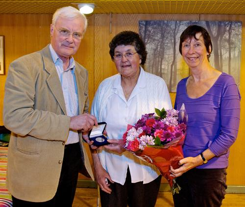 Dr Charles Fox presents Susan Parker with her RD Lawrence Medal with Dr Anne Kilvert at the Riverside Community Centre in Towcester