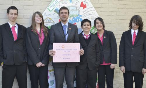 Mr Bowerman-Ellis (Head of House) with student representatives from the winning house, Kingswear, at The Bourne Academy