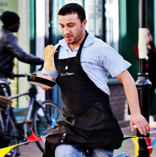 Apollo Cafe Business Winner in action at 2014 Pancake Day Races