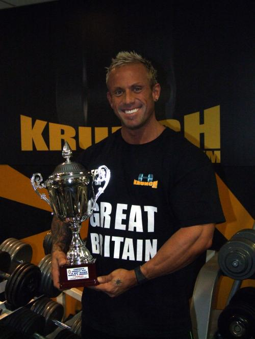 Mr Universe Neale Cranwell Owner of Krunch Gym with his winning trophy