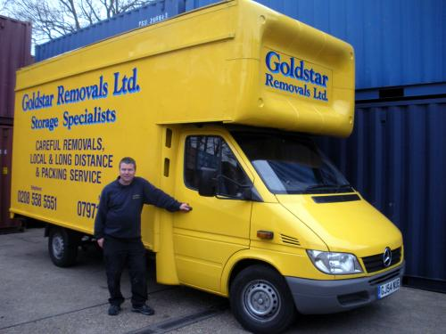Goldstar Removals yellow and blue van