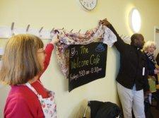 Rev Torchon opens the Welcome Cafe