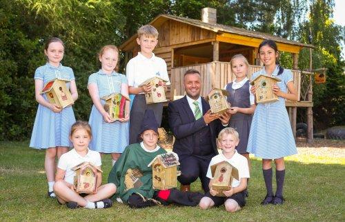 1.	Elan sales executive Ken Bracewell-Murray swooped in to Neston Primary School to see the bird boxes made with materials donated by the homebuilder