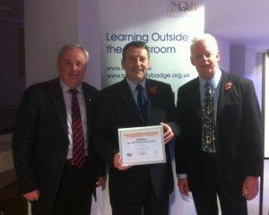 Steven Dool receives the award on behalf of Neston High School